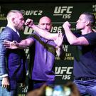 Face off: Conor McGregor and Nate Diaz are kept apart by UFC President Dana White at MGM Grand, Las Vegas