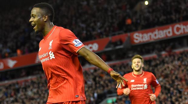 Ecstasy: Divock Origi celebrates after scoring Liverpool's opening goal in their 4-0 win over Everton