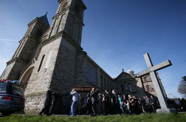 Press Eye Ltd Thursday 21st April 2016 - The funeral mass takes place at Holy Cross in North Belfast of Michael McGibbon, who was murdered in the Ardoyne area of the city last Friday evening. Mr McGibbon, 33, was shot three times in his legs in an alleyway at Butler Place. Photo Matt Mackey / Press Eye