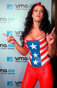 FILE - In this Sept. 7, 2000 file photo, WWF wrestler Chyna arrives for the 2000 MTV Video Music Awards, at New York's Radio City Music Hall. Chyna, the WWE star who became one of the best known and most popular female professional wrestlers in history in the late 1990s, has died at age 45. Los Angeles County coroners Lt. Larry Dietz says Chyna, whose real name is Joan Marie Laurer, was found dead in Redondo Beach on Wednesday, April 20, 2016. (AP Photo/Tina Fineberg, File)