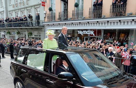 Queen Elizabeth II and Prince Philip, Duke of Edinburgh travel through Windsor in an open top Range Rover after her 90th Birthday Walkabout on April 21, 2016 in Windsor, England. Today is Queen Elizabeth II's 90th Birthday. The Queen and Duke of Edinburgh will be carrying out engagements in Windsor. (Photo by John Stillwell - WPA Pool/Getty Images)