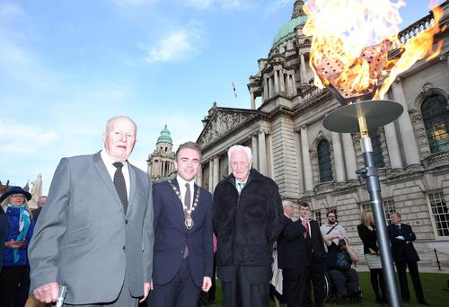 Two VIPs, both of whom celebrated their 90th birthday on the same day as The Queen (Thursday, 21 April), Albert Moore from East Belfast (left) and Austin Henderson from Stranmillis (right) assist Deputy Lord Mayor Alderman Guy Spence to light the beacon on the front lawn of City Hall. The Belfast tribute was part of a UK-wide beacon lighting programme marking the Royal birthday. Picture by Jonathan Porter/PressEye