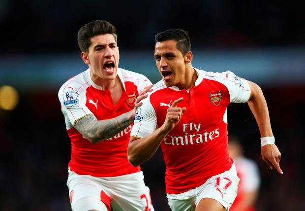 LONDON, ENGLAND - APRIL 21: Alexis Sanchez of Arsenal (L) celebrates with Hector Bellerin as he scores their first goal during the Barclays Premier League match between Arsenal and West Bromwich Albion at the Emirates Stadium on April 21, 2016 in London, England. (Photo by Paul Gilham/Getty Images)