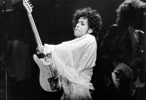 In this Dec. 25, 1984 photo, Prince performs at St. Paul Civic Center in St. Paul, Minn. Prince, widely acclaimed as one of the most inventive and influential musicians of his era with hits including