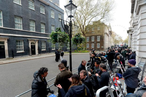 Media wait in Downing Street ahead of US President Barack Obama's visit to 10 Downing Street, London. PA