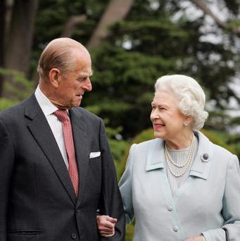 File photo dated 18/11/07 of Queen Elizabeth II and the Duke of Edinburgh re-visiting Broadlands in Hampshire to mark their diamond wedding anniversary, where 60 years ago in November 1947 they spent their wedding night as she turns 90 on the April 21st. Tim Graham/PA Wire