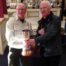 Prize guy: Tony Hogg (left) is presented with the Ulster Cup by Ulster secretary Woodrow Acheson after triumphing in the fly fishing competition