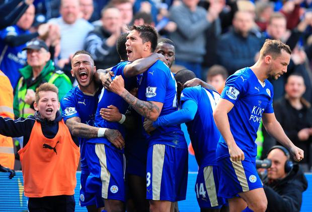 Out in front: Leonardo Ulloa celebrates scoring the equaliser against West Ham, which kept Leicester five points clear at the top of the Premier League table