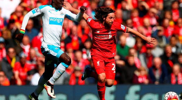 Papiss Demba Cisse of Newcastle United chases down Joe Allen of Liverpool during the Barclays Premier League match between Liverpool and Newcastle United at Anfield on April 23, 2016 in Liverpool, United Kingdom. (Photo by Clive Brunskill/Getty Images)