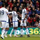 Chelsea's Willian (centre, left) celebrates scoring his side's third goal of the game with team-mate Chelsea's John Obi Mikel during the Barclays Premier League match at the Vitality Stadium, Bournemouth. Steve Paston/PA Wire