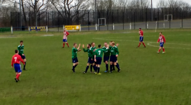 Downpatrick players celebrate a recent win over Albert Foundry... but could they have more to cheer by the end of their fixture-packed final month?
