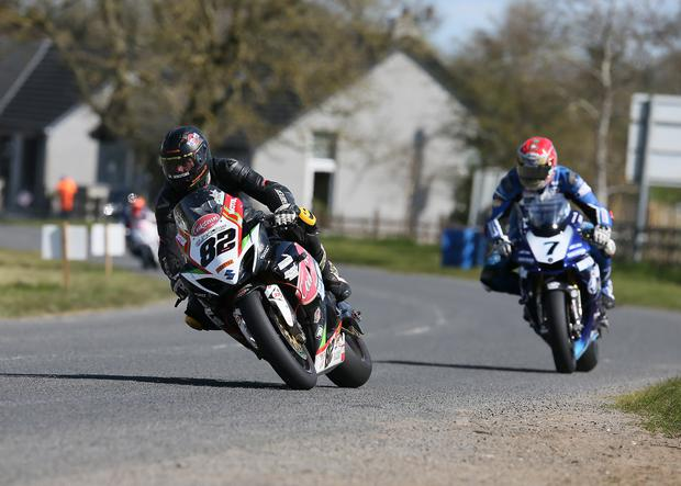 Derek Shields leads Dan Kneen in the contested Open class race at the Tandragee 100