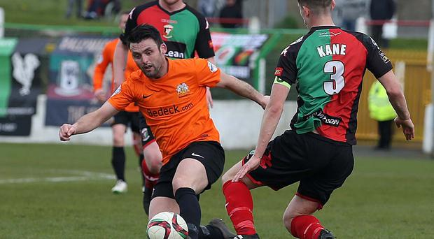 Eyes on the prize: Eoin Bradley and Marcus Kane challenge for the ball