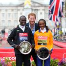 Royal approval: Men's winner Kenya's Eliud Kipchoge and women's race winner Kenya's Jemima Sumgong pose with Prince Harry