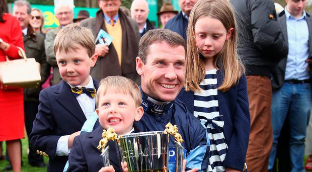 New champion jockey Richard Johnson with his sons Percy and Caspar and daughter Willow