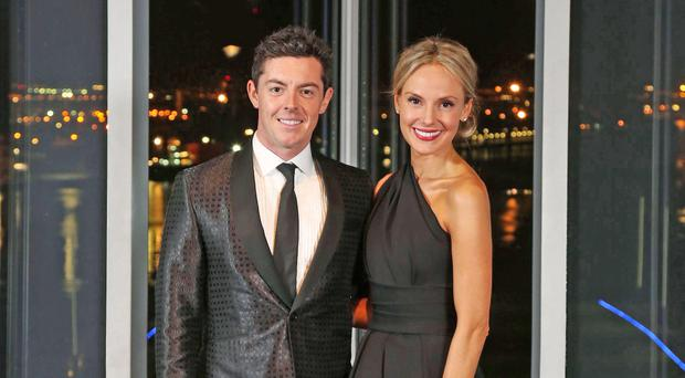 Glamorous couple Rory McIlroy and girlfriend Erica Stoll, left, at a recent charity ball in Titanic Belfast