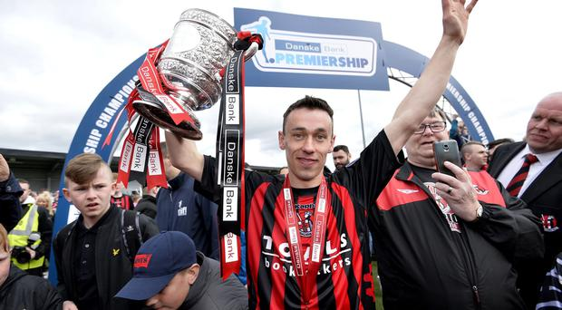 Danske Bank Irish premier league match between Crusaders and Coleraine at Seaview Belfast. Crusaders Paul Heatley celebrates with the Gibson cup. Photograph: Stephen Hamilton /Presseye