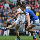 Getting his kicks: Ronan O'Neill nets for Tyrone in the Division Two final against Cavan at Croke Park