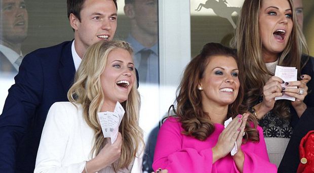 Girls allowed: Jonny Evans and his wife Helen, alongside Coleen Rooney, wife of England and Manchester United captain, Wayne