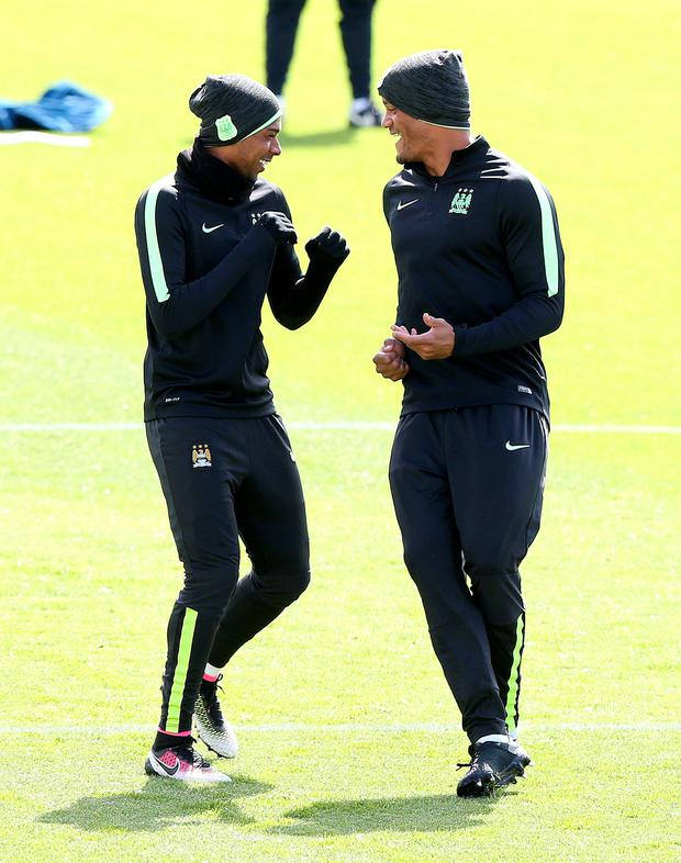 You're having a laugh: Fernandinho and Vincent Kompany share a joke during training