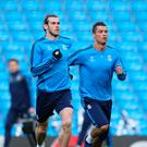 Star men: Gareth Bale and Cristiano Ronaldo train at the Etihad