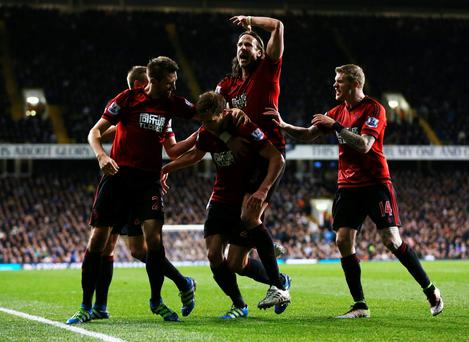 Craig Dawson of West Bromwich Albion (25) celebrates with team mates as he scores their first and equalising goal during the Barclays Premier League match between Tottenham Hotspur and West Bromwich Albion at White Hart Lane on April 25, 2016 in London, England. (Photo by Alex Morton/Getty Images)