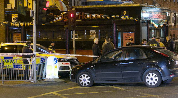 Gardai at the scene of a fatal shooting at the Sunset House pub in north Dublin last night