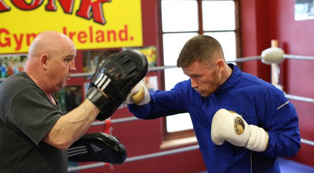 Big hitters: Belfast coach Tony Dunlop and featherweight James Tennyson can clinch the British title at London's Copper Box Arena