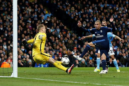 Manchester City goalkeeper Joe Hart (left) saves an effort on goal from from close by Real Madrid's pepe (right) during the UEFA Champions League, Semi-Final match at the Etihad Stadium, Manchester. PA