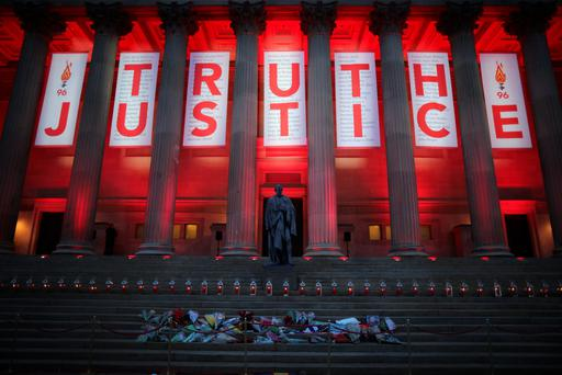 A banner reading Truth and Justice is hung from Liverpool's Saint George's Hall and illuminated in red after today's Hillsborough inquest verdict on April 26, 2016 in Liverpool, England. (Photo by Christopher Furlong/Getty Images)