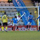 Head boy: Former Rangers defender Craig Halkett scores against goalkeeper Wes Foderingham to give Livingston a 1-0 victory over his old sideright,