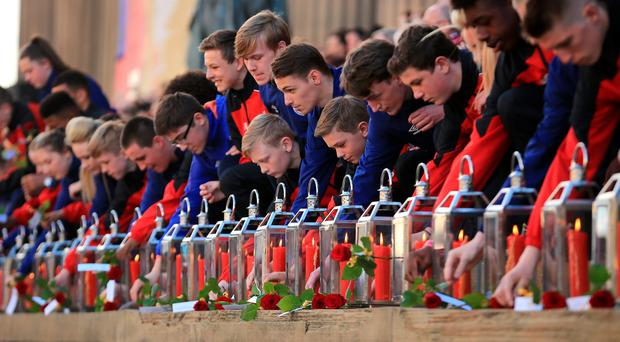 LIVERPOOL, ENGLAND - APRIL 27: Roses are placed beside 96 candles in memory of the victims outside Liverpool's Saint George's Hall as thousands of people gather to attend a vigil for the 96 victims of the Hillsborough tragedy on April 27, 2016 in Liverpool, England. The civic commemoration event marks the outcome of the fresh inquests into the 1989 Hillsborough disaster, in which 96 football supporters were crushed to death, and concluded yesterday with a verdict of unlawful killing. Relatives, Liverpool supporters and members of the public are taking part in the vigil at St George's Hall where a candle is lit for each of the 96 victims who lost their lives during a crush at the Hillsborough football ground in Sheffield, South Yorkshire in 1989.. (Photo by Christopher Furlong/Getty Images)