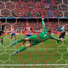 Goalkeeper Manuel Neuer of Bayern Munich fails to stop Saul Niguez of Atletico Madrid (not pictured) as he scores their first goal during the UEFA Champions League semi final first leg match between Club Atletico de Madrid and FC Bayern Muenchen at Vincente Calderon on April 27, 2016 in Madrid, Spain. (Photo by Alexander Hassenstein/Bongarts/Getty Images)
