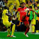 Finely balanced: Liverpool ace Jordon Ibe shows his ball control skills as Villarreal's Cedric Bakambu closes in