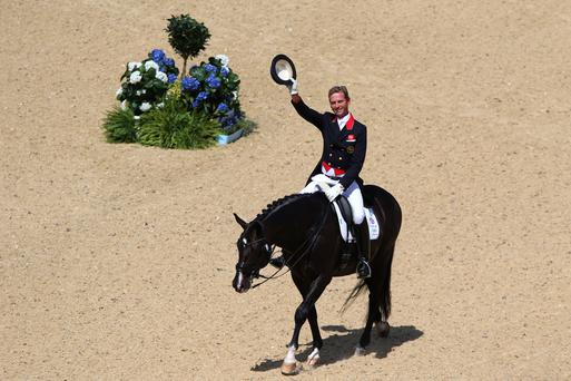 Carl Hester and Uthopia compete in the Dressage Grand Prix at the London 2012 Olympic Games. (Photo by Alex Livesey/Getty Images)