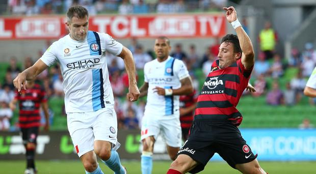 Let go: Aaron Hughes only played six times for Melbourne City, scoring once