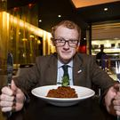 Sweat it out: Christopher Woodhouse takes on the Mumbai 27 lamb curry. Pic: Mark McCormick/Sunday Life.