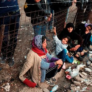 Thousands of displaced Syrians, Iraqis and Afghan's wait in deteriorating conditions to enter a reception center on the island of Lesbos. (Photo by Spencer Platt/Getty Images)