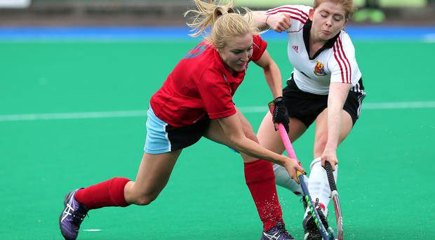 Fierce battle: Belfast Harlequins' Orlagh O'Shea and UCC's Emily Reidy fight for possession as Quins clinch an EYHL place
