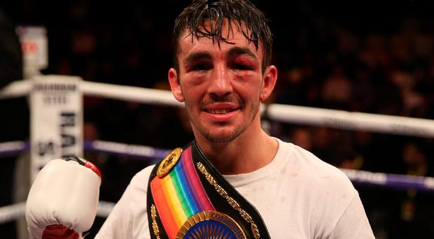 Big impact: Jamie Conlan celebrates victory over Anthony Nelson