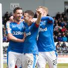 Lightning holt: Rangers ace Jason Holt (centre) celebrates scoring his side's second goal yesterday