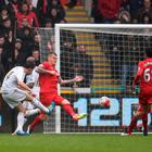 Red alert: Jack Cork finds the back of the Liverpool net at the Liberty Stadium as City cruise to a 3-1 victory, securing their Premier League future