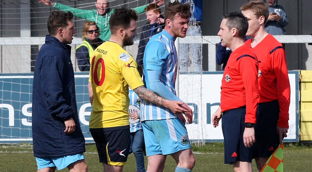 Costly: Dermot McVeigh leads the Warrenpoint protests towards controversial referee Ross Dunlop