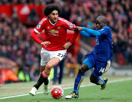 Hair raiser: United ace Marouane Fellaini seemed to elbow Robert Huth