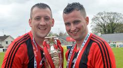 Harryville Homers captain Gary Bonnes and vice captain Ian Russell lift the Junior Cup after beating Rosemount Rec in last year's final. Will history repeat itself this time around?
