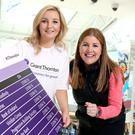 Hannah McHugh, assistant manager at Grant Thornton NI and Michelle Hatfield, director of human resources and corporate responsibility at Belfast City Airport, with details of some of the teams already signed up to run