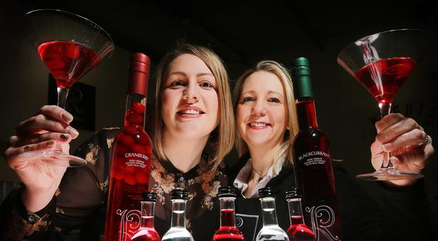 Jill Jones (left) from Asda's Local Sourcing Team and Barbara Hughes from Hughes Craft Distillery toast the new contract