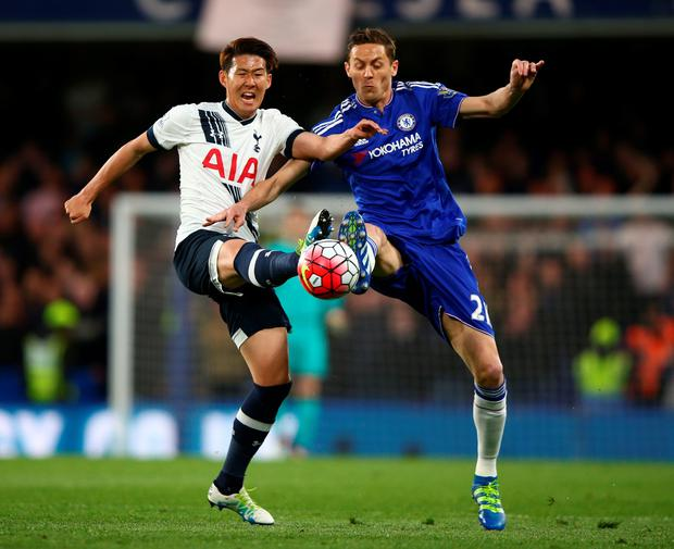 Son Heung-Min of Tottenham Hotspur and Nemanja Matic of Chelsea battle for the ball during the Barclays Premier League match between Chelsea and Tottenham Hotspur at Stamford Bridge on May 02, 2016 in London, England. (Photo by Ian Walton/Getty Images)