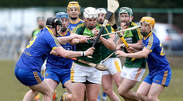 In the thick of it: Antrim hurling skipper Conor Carson takes it to Roscommon in the Christy Ring Cup
