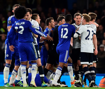 Hot battle: Chelsea and Tottenham players clash during the fiery 2-2 draw at Stamford Bridge